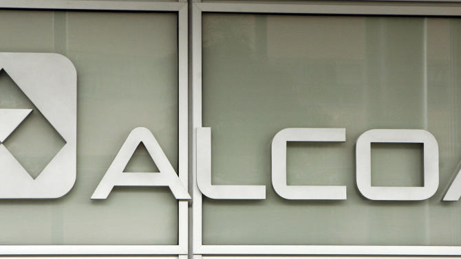 In this April 9, 2011, file photo, the Alcoa headquarters building in downtown Pittsburgh, Saturday, April 9, 2011. Aluminum manufacturer Alcoa Inc. said Monday, July 9, 2012, it lost $2 million in the second-quarter as revenue dropped due to weaker prices and pockets of declining demand in the slowing global economy. (AP Photo/Gene J. Puskar, File)