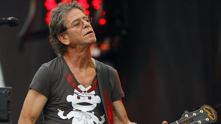 FILE - In this Sunday, Aug. 9, 2009 file photo, Lou Reed performs at the Lollapalooza music festival, in Chicago. Punk-poet, rock legend Lou Reed is dead of a liver-related ailment, his literary agen said Sunday, Oct. 27, 2013. He was 71. (AP Photo/John Smierciak, File)