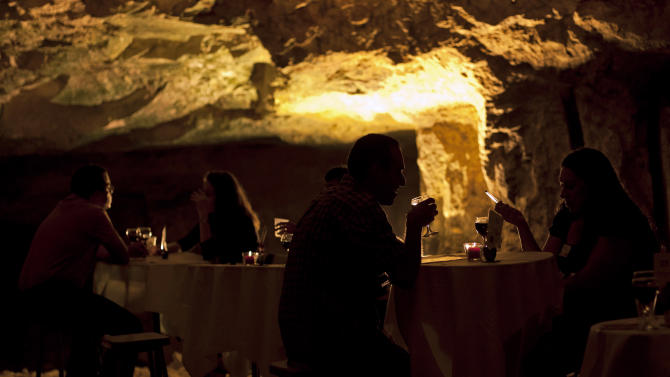 In this Aug. 14, 2011 photo, Israelis participate in a speed dating event on the eve of Tu Be'Av, the Jewish holiday of love, in Zedekiah's Cave, also known as Solomon's Quarries, under Jerusalem's Old City. Hoping the exotic setting would provide a conducive backdrop for romance, organizers brought 70 Israeli singles to the subterranean quarry late Sunday for the unique speed-dating marathon to mark the 15th day of the Hebrew month of Av, the Jewish holiday of love. (AP Photo/Sebastian Scheiner)