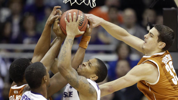 Kansas State guard Rodney McGruder (22) battles for a rebound with Texas forwards Jonathan Holmes (10) and Ioannis Papapetrou (33) during the first half of an NCAA college basketball game in the Big 12 tournament on Thursday, March 14, 2013, in Kansas City, Mo. Kansas State forward Jordan Henriquez (21) gets in on the play. (AP Photo/Orlin Wagner)