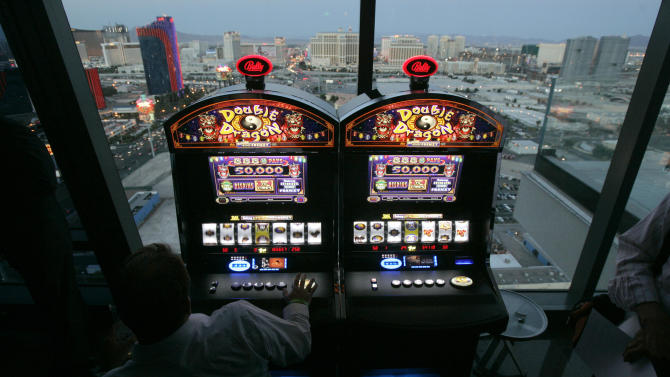 Scientific Games strikes $3.3B deal to buy Bally