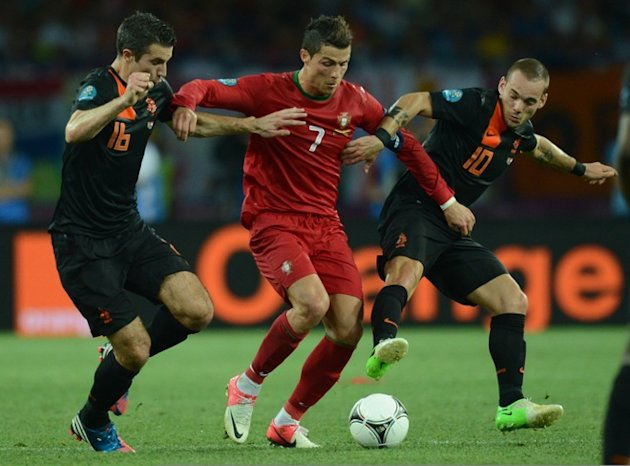 Portuguese Forward Cristiano Ronaldo (C) Vies With Dutch Midfielder Wesley Sneijder (R) And Dutch Forward Robin Van AFP/Getty Images