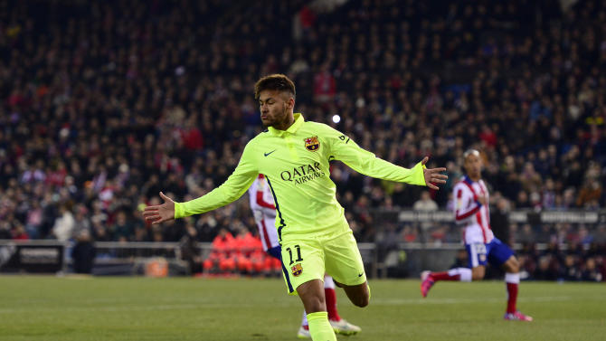 Neymar celebrates after scoring during Barcelona's King's Cup quarter final second leg against Atletico Madrid at the Vicente Calderon stadium in Madrid on January 28, 2015