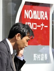 &lt;p&gt;A man walks past a branch of Japan&#39;s Nomura Securities in Tokyo. The firm said it planned to usher in the cuts by March 2014, chopping expenses from its wholesale division, which includes investment banking, equities and fixed-income businesses.&lt;/p&gt;