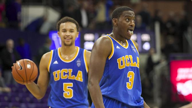 UCLA's Jordan Adams (3) and teammate Kyle Anderson react to defeating Washington in an NCAA college basketball game on Thursday March 6, 2014, in Seattle. UCLA won 91-82