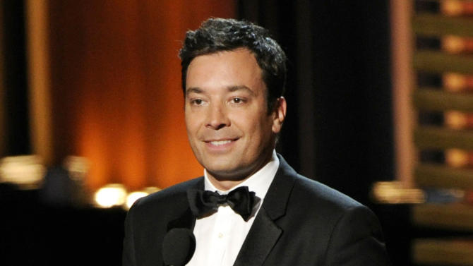 "FILE - In this Aug. 25, 2014 file photo, Jimmy Fallon presents an award at the 66th Annual Primetime Emmy Awards in Los Angeles. Fallon has a deal with Feiwel and Friends for the picture book ""Your Baby's First Word Will Be Dada."" Fallon says he was inspired by his daughter, Winnie Rose, whose first word, alas, was ""Mama."" The publisher announced Monday, Oct. 20, that the book is scheduled for release in June. (Photo by Chris Pizzello/Invision/AP, File)"