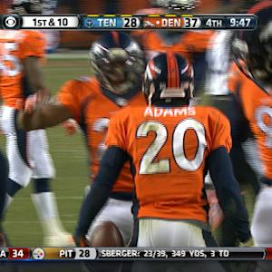 Tennessee Titans running back Chris Johnson's fumble recovered by Denver Broncos safety Mike Adams