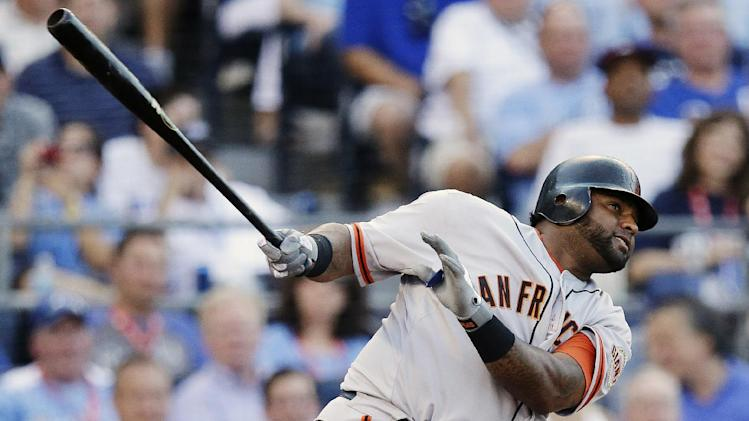 National League's Pablo Sandoval, of the San Francisco Giants, hits a three-run triple during the first inning of the MLB All-Star baseball game, Tuesday, July 10, 2012, in Kansas City, Mo. (AP Photo/Charlie Riedel)