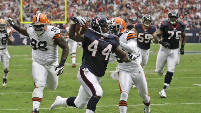 Houston Texans running back Ben Tate (44) runs in for a touchdown as Cleveland Browns' Phillip Taylor (98) and Mike Adams pursue during the first quarter of an NFL football game on Sunday, Nov. 6, 2011, in Houston. (AP Photo/David J. Phillip)