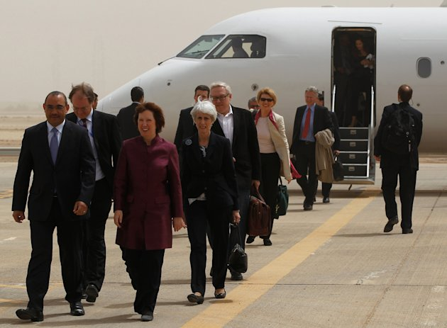 World powers negotiators arrive at the Baghdad International Airport in Iraq, Wednesday, May 23, 2012. Negotiators from the U.S. and five other world powers sat down Wednesday with a team of Iranian diplomats to try to hammer out specific goals in the years-long impasse over Tehran&#39;s nuclear program.(AP Photo/Mohammed Ameen, Pool)