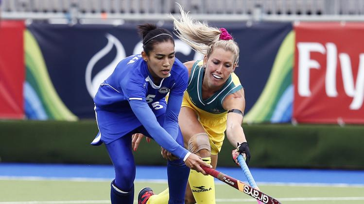 Australia's Eastham challenges Malaysia's Hasliza during their field hockey match at the 2014 Commonwealth Games in Glasgow, Scotland