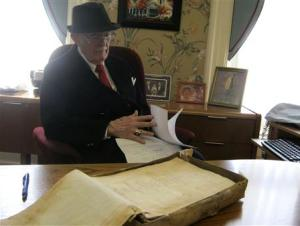 Dudley Martin looks at handwritten manuscripts written by Robert Stroud at his home in Springfield, Missouri