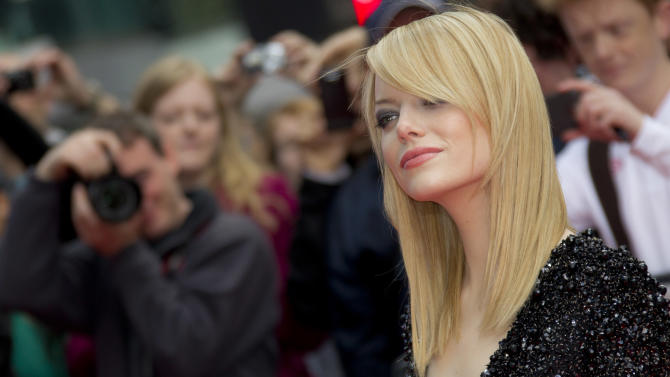 US actress Emma Stone arrives for the UK premiere of The Amazing Spider-Man at a central London cinema, Monday, June 18, 2012. (AP Photo/Joel Ryan)