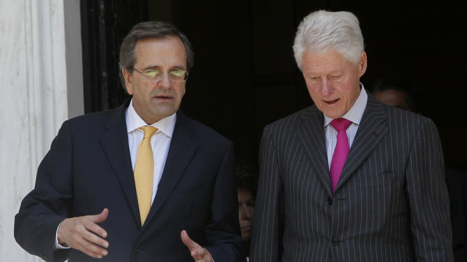 "Greek Prime Minister Antonis Samaras, left, and Former U.S. President Bill Clinton leave Maximos mansion after their meeting in Athens, Sunday, July 22, 2012. Clinton is in Greece to promote the ""Hellenic Initiative,"" an initiative by businessmen of Greek origin living abroad who want to facilitate foreign investment in the debt-ridden country and to raise (Canadian) $100 million to help charities active in Greece. (AP Photo)"