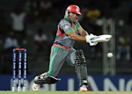 Afghan batsman Gulbodin Naib during their World Twenty20 match against England on September 21. He scored more than half of his team's runs before he was last man out for 44 off 32 balls that included five fours and three sixes