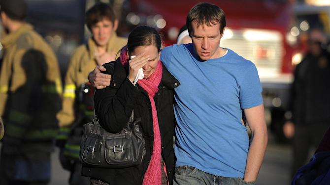 """FILE - In this Dec. 14, 2012 file photo, Alissa Parker, left, and her husband, Robbie Parker,  leave the firehouse staging after receiving word that their six-year-old daughter Emilie was one of the 20 children killed in the Sandy Hook School shooting in Newtown, Conn.  Alissa Parker told """"CBS This Morning"""" in an interview that aired Thursday, March 21, 2013, that she wanted to meet with Adam Lanza's father, Peter Lanza, to tell him """"something"""" she needed to get out of her system. It's not clear what that something was. CBS planned to show the rest of the interview with Alissa and Robbie Parker on Friday morning revealing more details about their meeting with Peter Lanza.   (AP Photo/Jessica Hill)"""