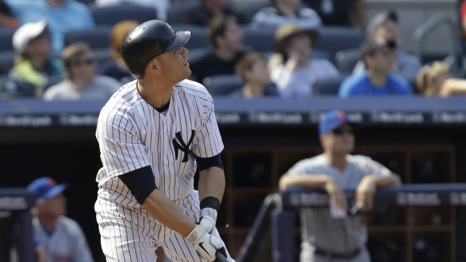 New York Yankees' Russell Martin watches his game-winning walk-off ninth-inning solo home run in the Yankees '5-4 victory over the New York Mets in a baseball game at Yankee Stadium in New York, Sunday, June 10, 2012. (AP Photo/Kathy Willens)