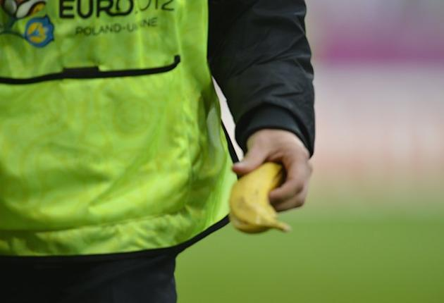 A Steward Holds A Banana   AFP PHOTO / ODD ANDERSENODD ANDERSEN/AFP/GettyImages AFP/Getty Images
