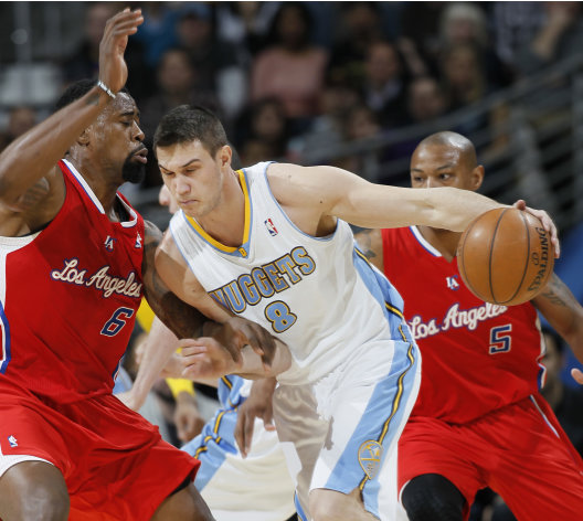 Denver Nuggets forward Danilo Gallinari, right, of Italy, works the ball inside against Los Angeles Clippers center DeAndre Jordan in the first quarter of an NBA basketball game in Denver, Thursday, March 7, 2013. (AP Photo/David Zalubowski)