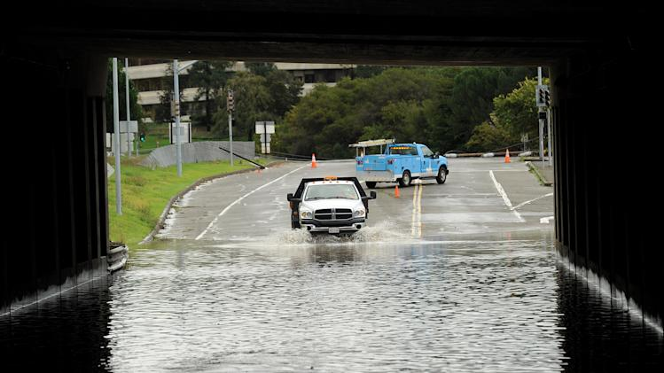 A traffic control vehicle transits a flooded underpass in San Rafael, Calif., on Sunday, Dec. 2, 2012. Days of heavy rains have left the region saturated and several rivers are expected to flood their banks Sunday afternoon. (AP Photo/Noah Berger)