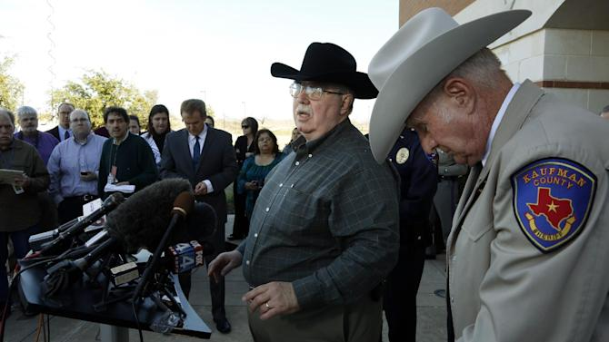 File- This Jan. 31, 2013 file photo shows David Byrnes, Sheriff of Kaufman County, right, bowing his head as Mike McLelland, District Attorney of Kaufman County answers questions at a news conference at the Kaufman Law Enforcement Center in Kaufman, Texas. McLelland and his wife where found dead in their home Saturday March 30, 2013. Authorities are investigating. (AP Photo/The Dallas Morning News, David Woo, File )
