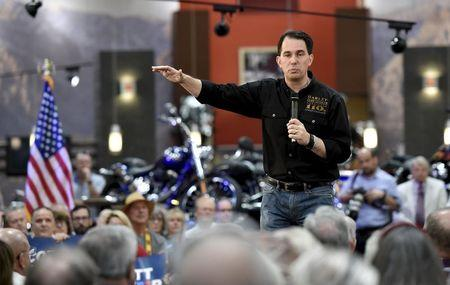 Republican presidential candidate and Wisconsin Governor Scott Walker speaks at a Harley Davidson motorcycle dealership in Las Vegas