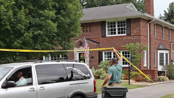 Glendale detectives lift the yellow tape to allow a hearse to leave a home following a murder-suicide in Glendale, Mo., on July 30, 2012.  Nearly two dozen investigators with the St. Louis Area Major Case Squad were looking into the shootings deaths of a suburban St. Louis woman and her two children, police said Tuesday.  Police haven't officially released the victims' names, but have said the children who were killed were ages 11 and 9.  (AP Photo/St. Louis Post-Dispatch, J.B. Forbes) EDWARDSVILLE INTELLIGENCER OUT; THE ALTON TELEGRAPH OUT