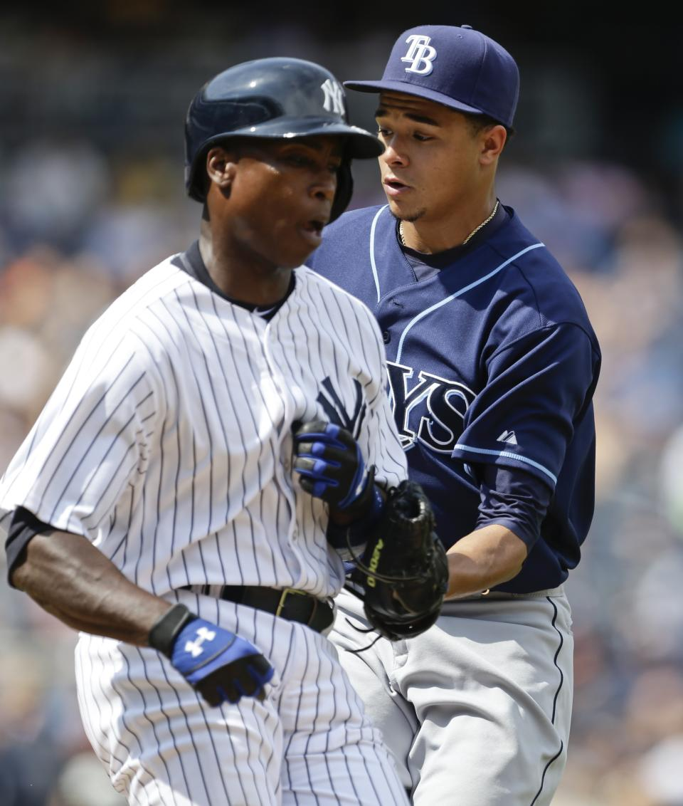 Tampa Bay Rays starting pitcher Chris Archer, right, tags out New York Yankees' Alfonso Soriano, during the seventh inning of a baseball game Saturday, July 27, 2013, in New York. (AP Photo/Frank Franklin II)
