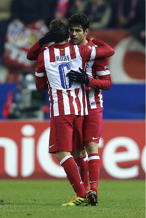 Atletico's Diego Costa, right, celebrates his goal with Koke, left, during their Champions League Group G soccer match between Atletico Madrid and FC Porto, at the Vicente Calderon stadium in Madr