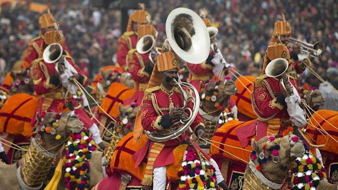 Musicians play instruments atop camels during the Republic Day Parade in New Delhi, India, Monday, Jan. 26, 2015. President Barack Obama is the Chief Guest for this year's parade. (AP Photo/Carolyn Kaster)