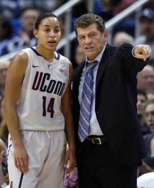 Connecticut coach Geno Auriemma speaks with Bria Hartley during the first half of an NCAA college basketball game against Baylor in Hartford, Conn., on Tuesday, Nov. 16, 2010. Connecticut won 65-64. (AP Photo/Fred Beckham)