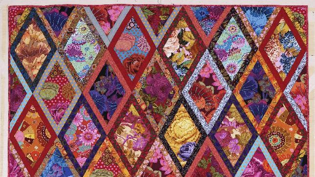 """This publicity photo provided by Abrams shows The Bordered Diamonds quilt from Kaffe Fassett's book """"Simple Shapes Spectacular Quilts"""" (STC Craft/A Melanie Falick Book, 2010) and it also appears in his autobiography, """"Kaffe Fassett: Dreaming in Color"""" (2012). He's taught workshops on this quilt throughout the world. (AP Photo/Abrams, Jon Stewart)"""
