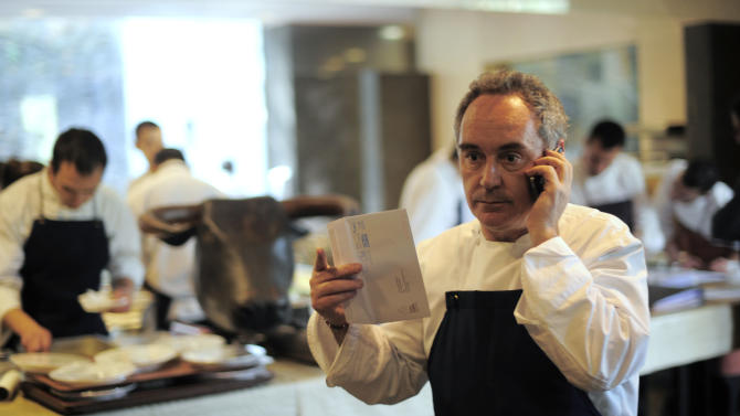 FILE - In this March 30, 2011 file photo, Spanish chef Ferran Adria as he speaks on the phone in his restaurant elBulli in Roses, Spain. El Bulli, one of the world's most acclaimed and award-winning eateries, is preparing to serve its last supper before closing. After a final dinner for staff families on Saturday, July 30, 2011, Adria will begin work on turning the restaurant into a food foundation he hopes to open in 2014.(AP Photo/Manu Fernandez, file)