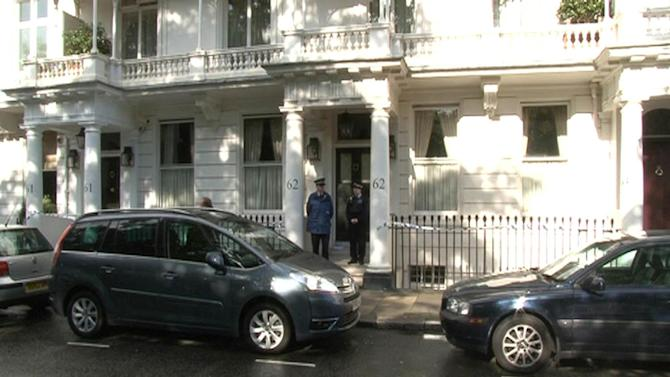 This photo taken from PA video shows police outside a house in Cadogan Place, Chelsea after the body of Eva Rausing, a member of the family behind the Tetra-Pak drinks carton empire and one of the richest women in Britain was found, Tuesday July 10, 2012. Eva Rausing, one of Britain's richest women, was found dead in her west London home and a man has been arrested in connection with her death, British police said Tuesday. Rausing, 48, was the American-born wife of Hans Kristian Rausing, heir to the multibillion-dollar TetraPak packaging fortune. They have both had long-running and often public battles against addiction. (AP Photo/PA Video, Leanne Rinne) UNITED KINGDOM OUT  NO SALES  NO ARCHIVE