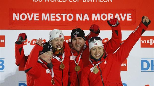 Norway's team members Tora Berger, Synnoeve Solemdal, Tarjei Boe and Emil Hegle Svendsen celebrate their first place in the mixed 2x6+2x7.5 km relay during the IBU World Championships biathlon in Nove Mesto February 7, 2013. (Reuters)