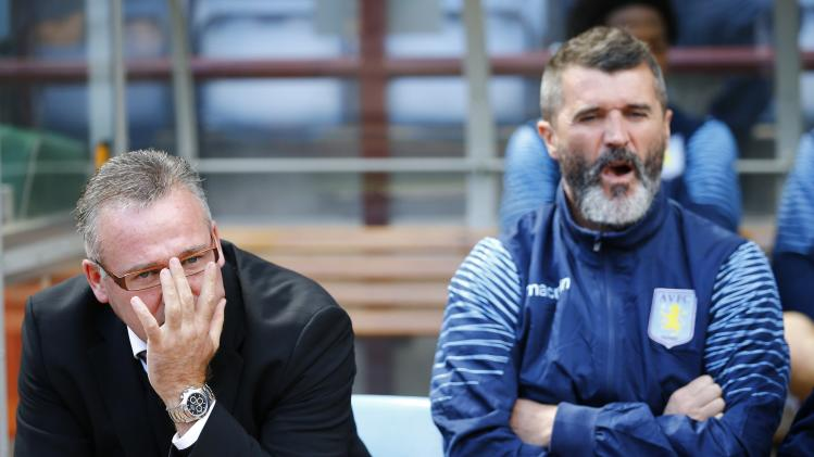 Aston Villa manager Lambert and his assistant Keane sits in the dugout before their English Premier League soccer match against Newcastle United at Villa Park in Birmingham