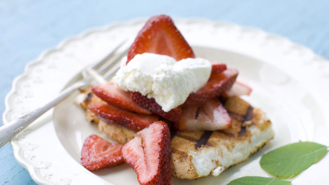 This May 30, 2012 image shows a dessert of spiced and grilled angel food cake with strawberries and whipped cream in Concord, N.H. (AP Photo/Matthew Mead)
