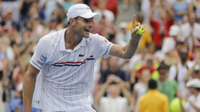 Andy Roddick celebrates after beating Italy's Fabio Fognini in the third round of play at the 2012 US Open tennis tournament,  Sunday, Sept. 2, 2012, in New York. (AP Photo/Mike Groll)