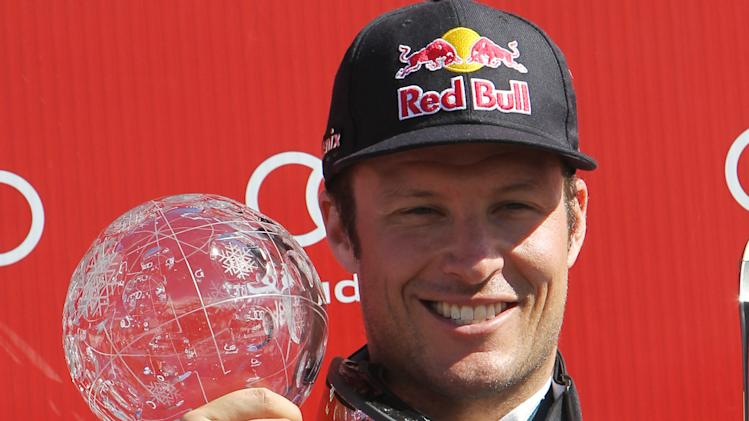 Norway's Aksel Lund Svindal shows the crystal globe trophy of the men's alpine skiing downhill at the World Cup finals in Lenzerheide, Switzerland, Wednesday, March 12, 2013. (AP Photo/Armando Trovati)