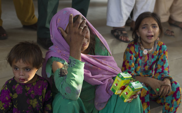Family members of a victim of a bus accident cry at a local hospital in Kahuta, near Rawalpindi, Pakistan, Monday, June 4, 2012. The bus carrying a wedding party into a ditch in Kahuta, killing 20 peo
