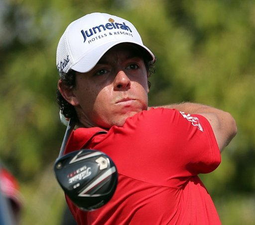 Rory McIlroy plays a shot in the DP World Tour Championship in Dubai on Sunday. McIlroy responded in magnificent fashion to Justin Rose&#39;s course record round of 10-under par 62 by making five birdies in his last five holes to win the DP World Tour Championship in Dubai on Sunday
