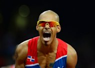 Dominican Republic&#39;s Felix Sanchez celebrates after winning the men&#39;s 400m hurdles final at the London Olympics on August 6. Sanchez defied all expectations when he regained his 400m hurdles title, at the age of 34 and after a gap of eight years