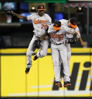 Baltimore Orioles outfielders Xavier Avery (70), Endy Chavez (27) and Nate McLouth celebrate after defeating the Seattle Mariners in a baseball game Monday, Sept. 17, 2012, in Seattle. Baltimore won 10-4. (AP Photo/Elaine Thompson)