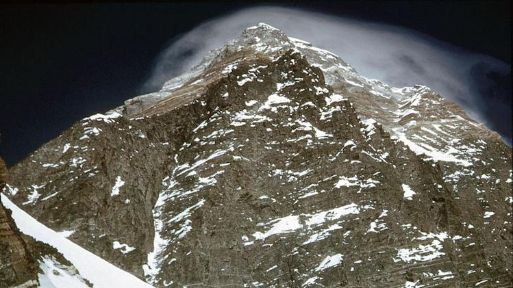 This 1963 photo released by Henry S. Hall, Jr. American Alpine Club Library, Barry Corbet Personal Papers and Films, shows the summit of Mt. Everest. Surviving members of the first American expedition team to reach the top of Mt. Everest are celebrating the 50th anniversary of their mountaineering milestones. Jim Whittaker rweached the top of the world on May 1, 1963, a decade after Britain's Edmund Hillary. Three weeks later, two other Americans, Tom Hornbein and Willi Unsoeld, became the first men ever to scale Everest via more dangerous route on the mountain's west side. (AP Photo/Henry S. Hall, Jr. American Alpine Club Library, Barry Corbet Personal Papers and Films)