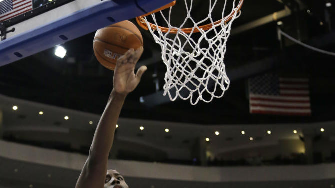 Syracuse's Rakeem Christmas, top, goes up for a shot against Villanova's Tony Chennault during the first half of an NCAA college basketball game, Saturday, Jan. 26, 2013, in Philadelphia. (AP Photo/Matt Slocum)