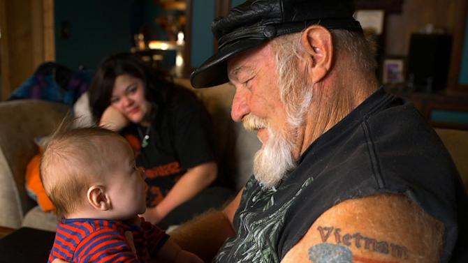 """This photo provided by Still Rolling Productions shows, Robin Smith, left, and Ron """"Stray Dog"""" Hall, in a scene from the documentary film, """"Stray Dog,"""" directed by Debra Granik. (Eric Phillips-Horst/Still Rolling Productions via AP)"""