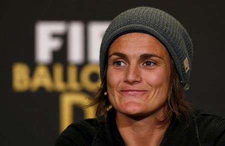 FIFA Women's World Player of the Year 2013 nominee Angerer of Germany smiles during a news conference ahead of the FIFA Ballon d'Or soccer awards ceremony in Zurich