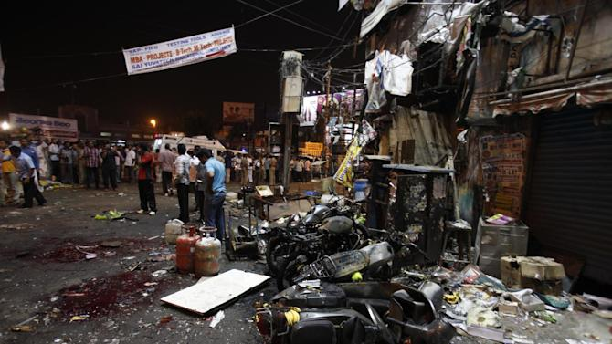 Damaged two wheelers lie near the site of a bomb blast in Hyderabad, India, Thursday, Feb. 21, 2013. A pair of bombs exploded Thursday evening in a crowded shopping area in the southern Indian city of Hyderabad, killing several people and wounding many in the worst bombing in the country in more than a year, officials said. (AP Photo/Mahesh Kumar A.)