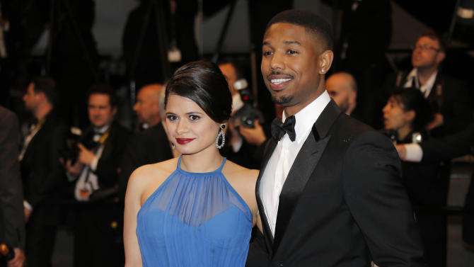 Actors Michael B. Jordan, right, and Melonie Diaz pose for photographers as they arrive for the screening of the film Heli at the 66th international film festival, in Cannes, southern France, Thursday, May 16, 2013. (AP Photo/Lionel Cironneau)