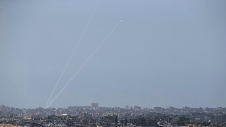 Smoke trails are seen as rockets are launched from the Gaza Strip towards Israel